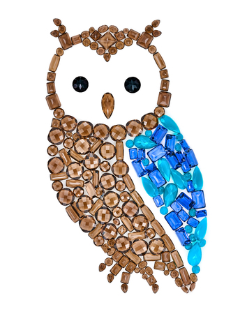 placer: Owl gemstones. Luxury shiny glamor colorful placer. Awesome precious stones mosaic. Multicolored sapphire bird, creative unusual decoration. Concept, Feng Shui symbol of wisdom and wealth, isolated