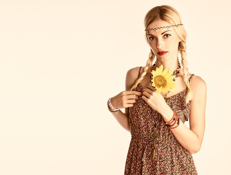 sundress: Hippie Boho woman Having Fun. Playful positive Model Summer Fashion Outfit. Happy Blonde, Trendy Sundress with sunflower, Fashion Accessories. Boho romantic fashion Summer Style. Unusual creative look Stock Photo