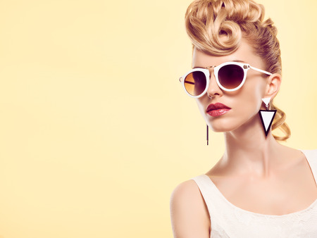 cheeky: Fashion portrait Hipster Model woman, Stylish hairstyle. Fashion Makeup. Blond sexy Model, Trendy Glamour fashion Sunglasses. Playful cheeky fashion girl. Unusual Creative.Party disco mohawk hairstyle