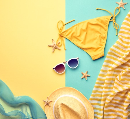 Fashion. Summer Beach Outfit. Summer clothes, Accessories Stylish girl set. Summer Fashion woman swimsuit Bikini, Sunglasses hat.Essentials creative art. Tropical sea.Unusual top view.Vacation concept Imagens