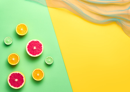 minimal: Fashion. Tropical Fruit Citrus Orange Grapefruit Lime Kiwi. Bright Color. Creative Art. Minimal. Fashion creative. Summer Beach Concept. Minimal