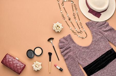 Fashion woman Clothes Accessories Set. Essentials Fashion Cosmetic Makeup. Stylish Lady Dress, Handbag, Glamor Heels, Rose. Trendy fashion Design. Top view. Fall Fashion. Vintage. Cosmetic Overhead Stock Photo