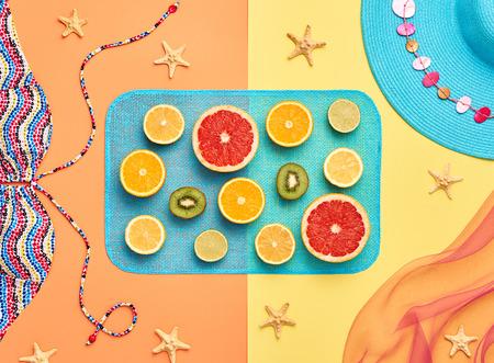 Fashion. Tropical Fresh Summer Set. Fashion Design. Bright Color. Fashion Stylish Accessories Fruit. Citrus. Fashion Glamor woman Swimsuit Bikini. Minimal. Top View. Creative Art Concept. Essentials Banco de Imagens - 64450080