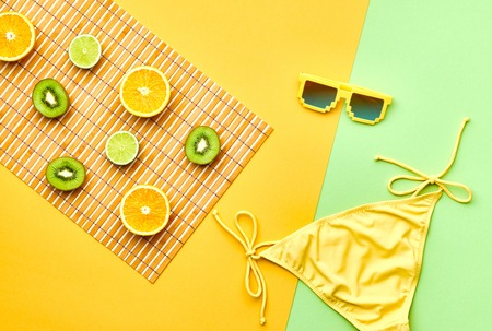 Fashion. Tropical Fresh Summer Set. Fashion Design. Bright Color. Fashion Stylish Accessories Fruit. Citrus. Fashion Glamor woman Swimsuit Bikini. Minimal. Top View. Creative Art Concept. Essentials Stok Fotoğraf - 64450217