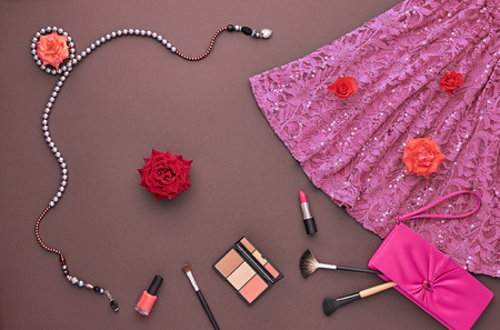 party outfit: Fashion woman Clothes Accessories Set. Fashion Cosmetic Makeup. Stylish Dress Glamor fashion Handbag Clutch, Rose. Fashion Design Party Outfit. Top view. Creative Cosmetic Overhead. Essentials.Minimal Stock Photo
