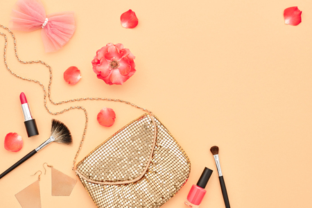 Fashion Cosmetic Makeup.Woman Beauty Accessories Set. Essentials. Fashion Design. Lipstick Brushes Eyeshadow, fashion Glamor Stylish Gold Clutch, Rose.Minimal Concept. Top view.Party Cosmetic Overhead