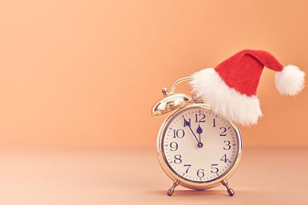 hat new year happy new year festive: New Year background decoration Handmade, Christmas holiday Gold Alarm Clock, Santa hat, Happy New Year 2017. XMAS Design Ornament. Festive Art christmas Greeting Card. Retro Vintage
