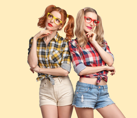 Fashion Hipster woman Thinking Idea. Having Fun. Hipster Sisters Best Friends Smile. Twins in Trendy Plaid Shirt. Funny Model Girl Fashion Sunglasses think. Nerd in Glamour fashion Outfit, Hairstyle