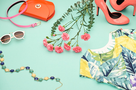 Fashion Design Spring girl clothes set,accessories. Trendy sunglasses, floral dress, fashion handbag clutch, flowers.Glamor shoes heels Summer lady.Creative urban.Pastel spring colors.Perspective view Imagens