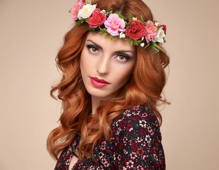 Fashion Boho woman Flower Wreath Portrait. Beauty Redhead Stylish wavy flower Shiny Curly Volume Hairstyle, fashion Makeup. Beautiful Glamour lady, fashion. Trendy summer Dress. Playful Girl, Ethnic