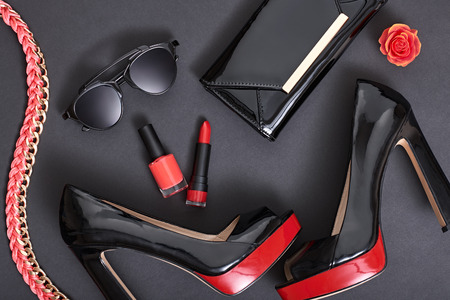 Fashion Design Woman Accessories Set. Cosmetic Makeup. Trendy fashion Sunglasses, Handbag Clutch. Glamor Stylish Black Red fashion shoes Heels. Luxury Party Night Out lady on Black. Art. Minimal Banco de Imagens