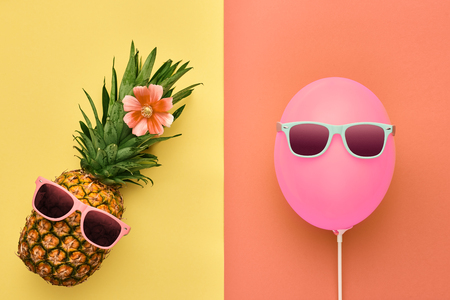 fashion art: Fashion Pineapple and Pink air Balloon. Bright Summer Color, Accessories. Tropical Hipster pineapple with Sunglasses. Creative Art concept. Minimal style. Summer party background. Fun Stock Photo