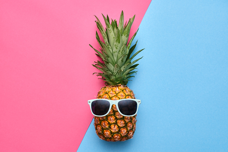Fashion Hipster Pineapple Fruit. Bright Summer Color, Accessories. Tropical pineapple with Sunglasses. Creative Art concept. Minimal style. Summer party background Stock Photo