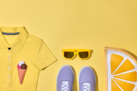 Summer Hipster Girl Accessories Set. Fashion Design. Hot Summer Sunny Vibes. Glamor Orange Citrus Clutch, Trendy Sneakers, fashion Sunglasses on Yellow. Sweet Style. Vanilla Pastel Color.Minimal, Art