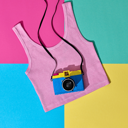 Fashion Film Camera. Hot Summer Vibes. Pop Art. Hipster Clothes Set, Trendy Top. Urban summer Outfit. Creative Retro Design camera. Bright Sweet fashion Style. Minimal Fun. Vanilla Pastel Colors Stock Photo
