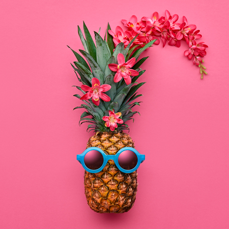 Pineapple Fruit Fashion Hipster. Hot Summer Beach Vibes. Summer party Mood. Tropical pineapple with Sunglasses. Bright Summer Color, Accessories, tropic flower. Creative Fun Art Style. Minimal Design. Stock Photo - 83627472