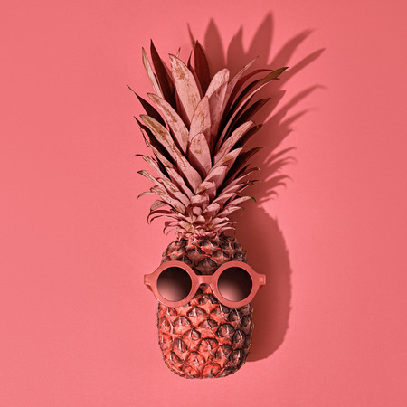 Pineapple Fruit Fashion. Bright Summer Color, Accessories. Tropical pineapple with Sunglasses. Creative Art Style. Party Mood on Pink
