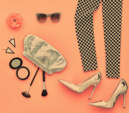 Fashion Design Outfit. Essentials fashion Cosmetic Makeup. Woman Clothes Accessories Set. Stylish Leggings, Glamor fashion Heels, Trendy Handbag Clutch, Sunglasses. Top view. Creative. Minimal