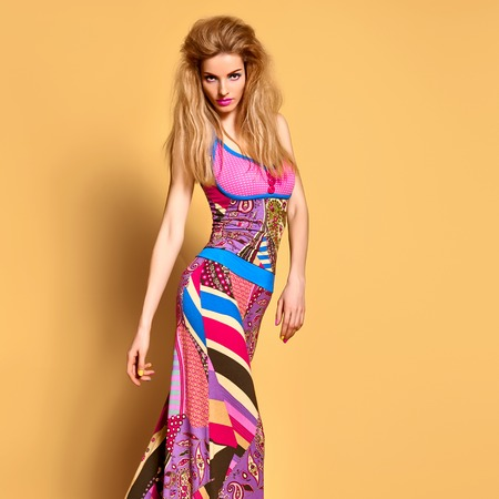 Fashion. Young woman in Summer Outfit, Glamor Hairstyle, Trendy fashion Makeup. Playful Pretty girl in fashion pose. Beautiful Sexy Blond Model, Stylish Summer Colorful look. Bright Colors Zdjęcie Seryjne
