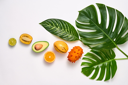 Tropical Palm Leaves and Fresh Fruits. Summer set. Nature green Layout. Colorful Design. Creative Art. Healthy Food concept. Bright Summer background. Flat lay.