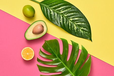Tropical Palm Leaves and Fresh Fruits. Colorful Summer Trendy Design Set. Fashion concept. Creative Bright summer background, Beach. Minimal art Zdjęcie Seryjne