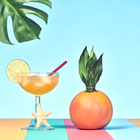 Tropical Grapefruit with Cocktail on Beach Stock Photo