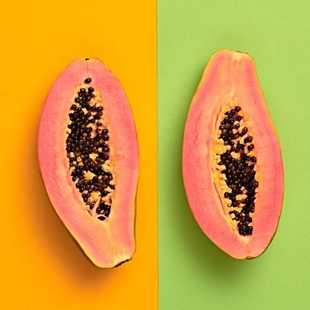 Papaya Tropical Fruit. Bright Sweet Color. Flat lay. Trendy fashion Style. Minimal. Hot Summer Vibes. Pink papaya, Surreal. Detail, Pop Art