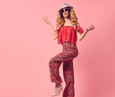 Fashion Glamour Beautiful Blond Lady. Fashionable Hairstyle, Luxury Trendy Sunglasses. Sensual Woman in Summer Stylish fashion Outfit, Heels. Young Playful female Model Girl. Art Studio