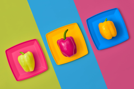 Pepper Fresh Veg. Colorfull Vegetables. Pepper on plate. Food Organic Vegan Concept. Flat lay. Trendy fashion Style. Minimal Design Art. Hot Summer Vibes. Bright Green Color. Stock Photo