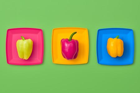 Pepper Fresh Veg. Food Organic Vegan Concept. Flat lay. Trendy fashion Style. Minimal Design Art. Hot Summer Vibes. Colorfull Vegetables. Pepper on plate. Bright Green Color. Stock Photo