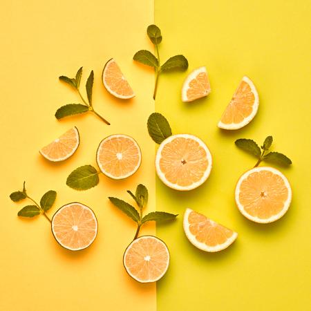 Orange Citrus Fresh Fruit with Mint leaves. Vegan Organic Food Concept. Creative Layout. Flat lay. Trendy fashion Style. Minimal Design Art. Hot Summer Vibes. Bright Color. Zdjęcie Seryjne