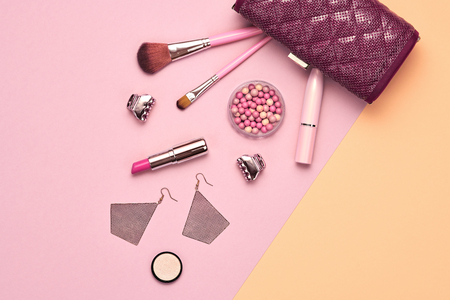 Fashion Makeup Cosmetic Set. Woman Beauty Accessories. Essentials. Design. Lipstick Brushes, Glamor Stylish Clutch Bag. Creative Concept. Flat lay.