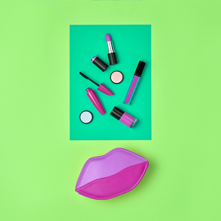 Cosmetic Minimal Makeup Set. Woman Fashion Beauty Accessories. Essentials. Trendy Design Clutch Bag. Lipstick Brushes Mascara. Creative Neon Color. Art Concept Style. Flat lay.