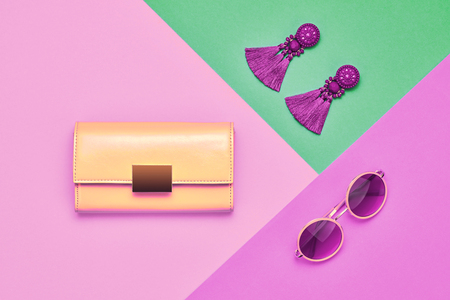 Fashion Glamour Summer Lady. Trendy Pink Handbag Clutch. Stylish Summer Sunglasses, Earrings. Vintage Party Concept. Minimal woman Accessories. Purple Color