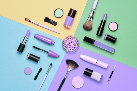 Fashion Cosmetic Makeup Set. Collection Beauty Products Accessories. Woman Essentials. Layout. Trendy Design. Lipstick Brushes Eyeshadow. Creative Bright Color. Art Concept Style. Flat lay. Stock Photo