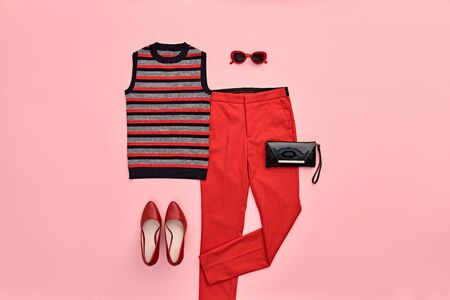 Autumn Arrives. Fashion Lady Clothes fall Outfit. Trendy top, red trousers. Stylish Handbag, Glamour heels, fashionable mood. Creative design autumnal Accessories Flat lay, pink color
