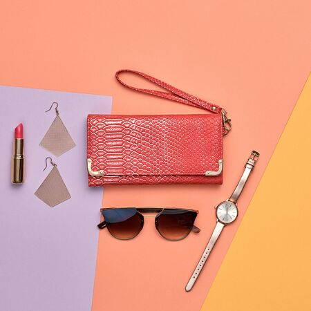 Fashion cosmetic makeup autumn Set. Collection beauty product on coral art background. Trendy accessories Brushes lipstick, handbag. Creative design Flat lay, make up fall fashionable concept
