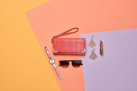 Woman beauty cosmetic makeup accessories Flat lay. Fashion Minimal autumn Set. Trendy Design Clutch, lipstick brushes. Art Concept fall Style. Creative fashionable cosmetic, orange color.