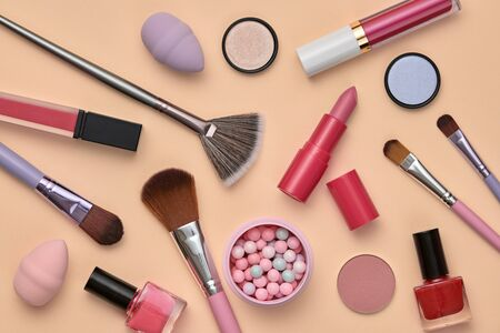 Fashion pink beauty product fall layout. Woman Essentials cosmetic makeup autumn coral Set. Collection beauty accessories. Brushes, lipstick, art Design Flat lay. Creative make up cosmetic concept