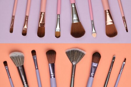 Fashion cosmetic makeup autumn Set. Collection beauty product on coral purple background. Trendy accessories Brushes Eyeshadow art fashionable layout. Creative Flat lay, make up fall autumnal concept