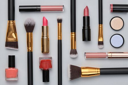 Fashion beauty product fall layout. Woman Essentials cosmetic makeup coral autumn Set. Collection beauty accessories. Trendy Brushes, lipstick, art Design Flat lay. Creative make up cosmetic concept