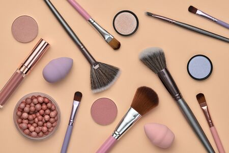 Fashion beauty product fall layout. Woman Essentials cosmetic makeup autumn Set. Collection beauty accessories. Trendy Brushes, lipstick, accessories art Flat lay. Creative make up shopping concept Фото со стока