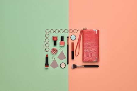 Fashion beauty product layout. Woman Essentials cosmetic makeup Set. Collection beauty accessories. Trendy Clutch, Brushes, lipstick, accessories. Coloful art Flat lay. Creative make up concept