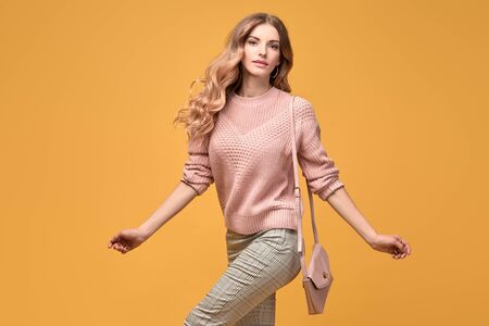 Fashionable autumn woman with stylish hairstyle, makeup dance. Carefree happy blonde girl having fun, trendy pinkoutfit, fashion hair. Sensual happy female model, dancing fun concept