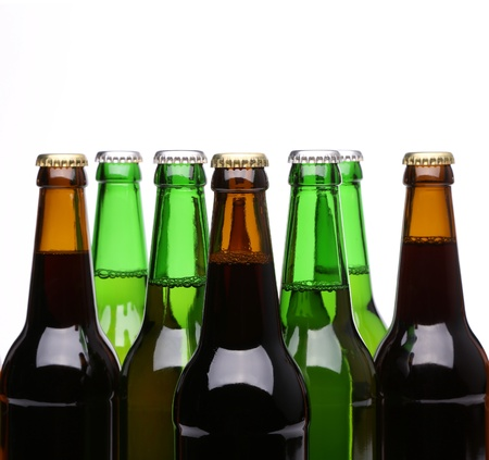 Closed bottles of beer isolated on a white background photo