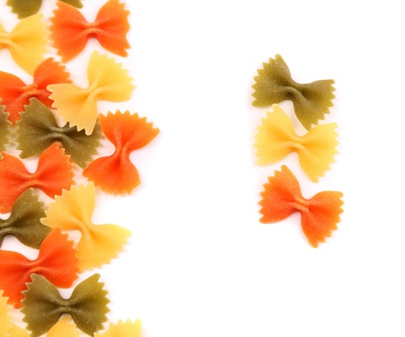 A composition of different pasta in three colors on the white background. photo
