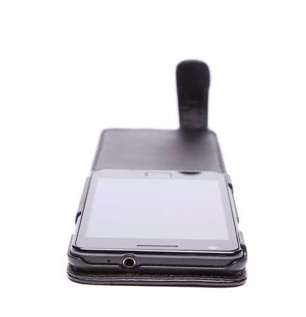 Mobile phone in its case over white background photo