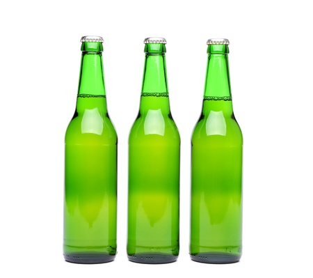 Three green beer bottle with drops drink without label on a white background photo