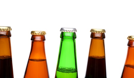 bottlenecks: A row of top beer bottlenecks on a white background with a reflection. Stock Photo