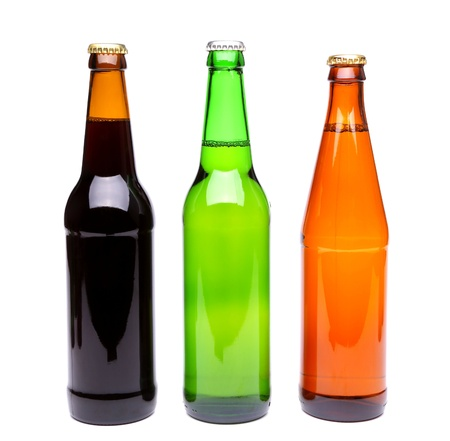 closing time: Three bottles of beer close-up on the white background